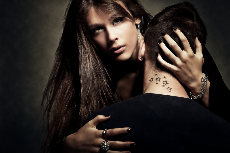 woman holding man with tattoos